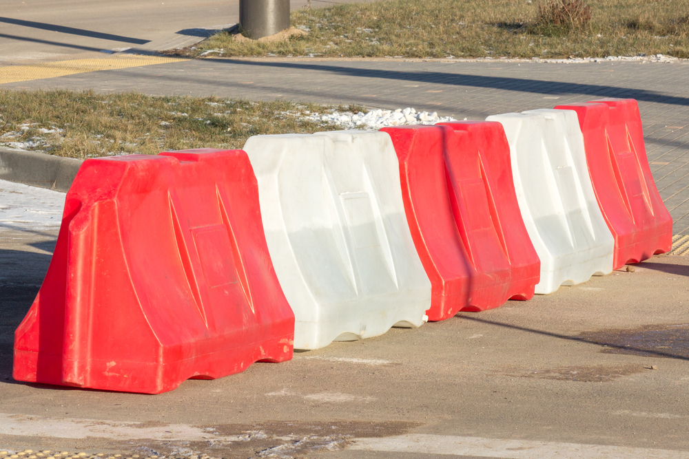 plastic red-white barrier on road, traffic safety with restrictions. well-marked design on the road, Traffic barricade rentals washington dc, baltimore, virginia